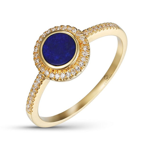 This Beautiful Round Deep Blue Lapis Stone is Bezel Set into this 14 Karat Yellow Gold Ring, designed by Luvente. Round Sparkling Diamonds Halo the Gemstone and Down the Sides of the Ring.   Top of Ring Measures 8.0mm  Finger Size 6.25  Total Diamond Weight = .10 Carat