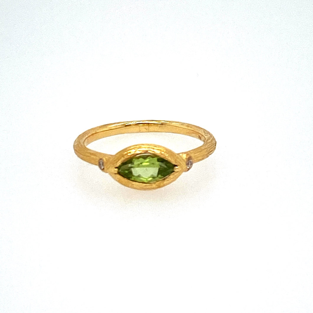 Loving the Way This Peridot is set Sideways into this 18 Karat Yellow gold (Brushed Finish) with an Accent Diamond on each Side  Finger Size 7
