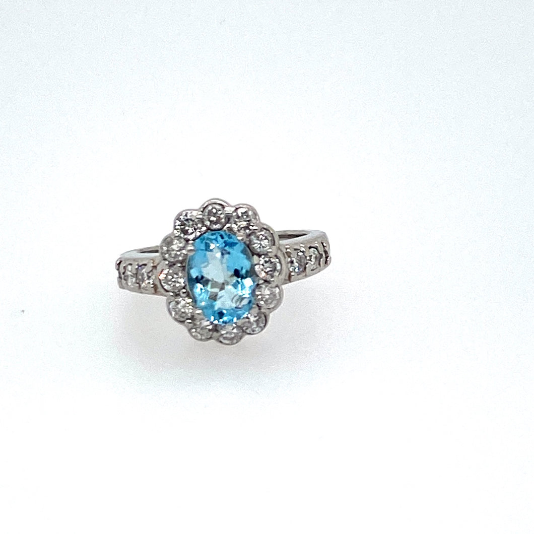 This Beautiful Blue 1.08 Carat Oval Aquamarine is Embellished with .50dtw of Sparkling White Diamonds going Around the Stone and Down the Sides of the Ring.  Total Weight 7.8 Grams  Finger Size 4.75  Estate Ring - all weights are approximate