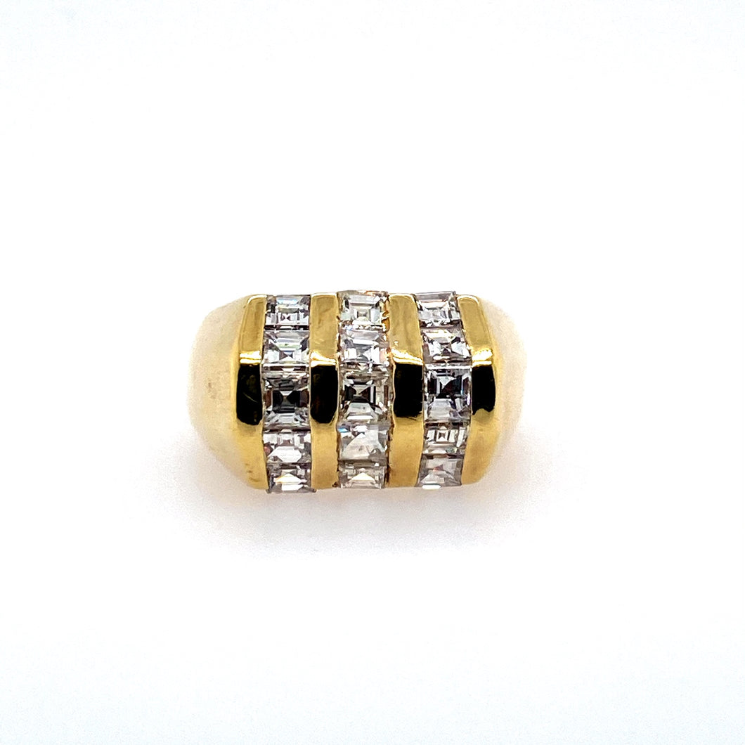 This Estate 14 Karat Yellow Gold Diamond Fashion Ring Features Three Rows of Square Step-Cut VS Diamonds Channeled into High Polished Yellow Gold.    Finger Size 8  Approximate Total Diamond Weight  2.50 Carats (VS Clarity)  Total Weight 9.3 Grams