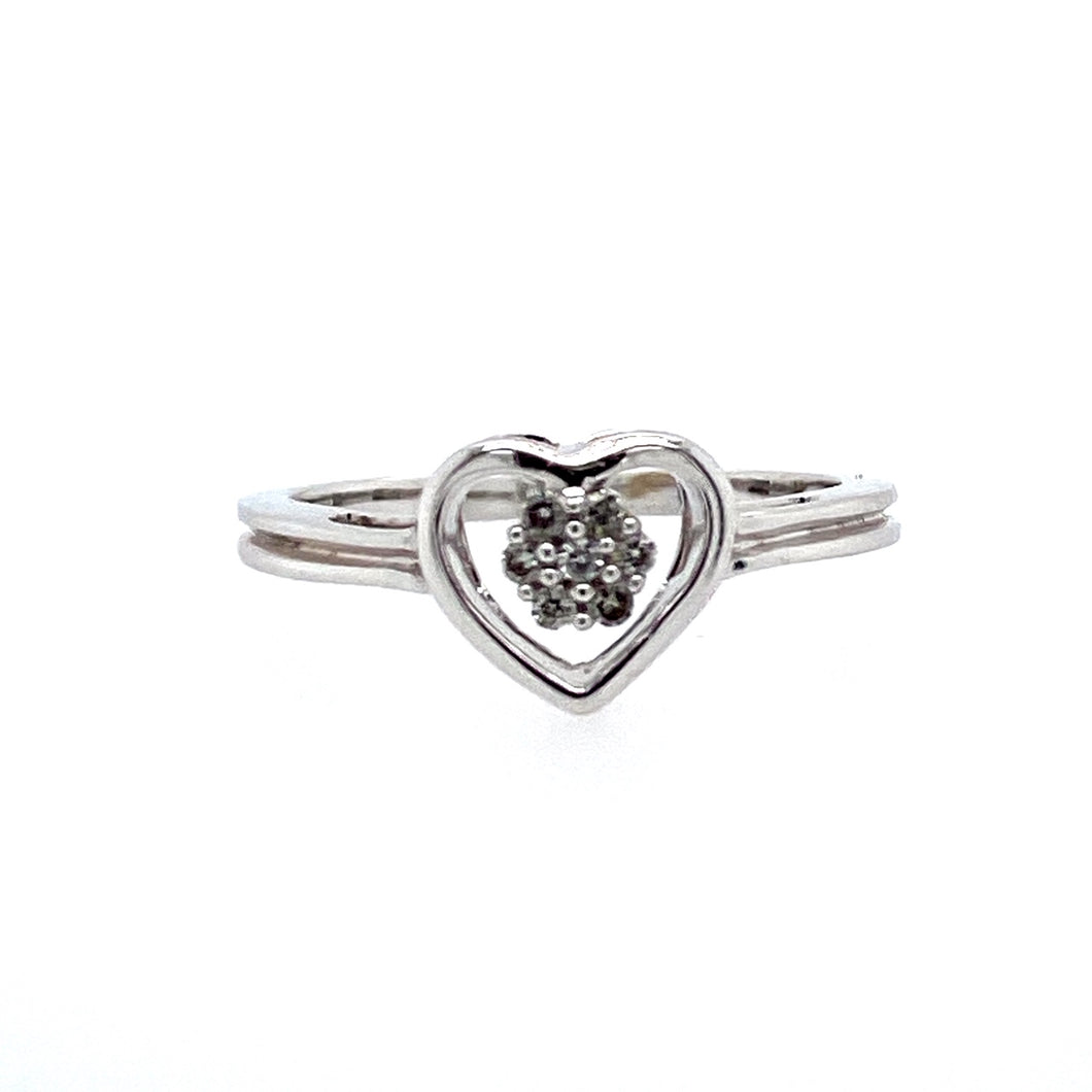 This 14 Karat White Gold Estate Ring Features an Open Heart Design with a Diamond Cluster in the Open Center.  Ring Size 6.5