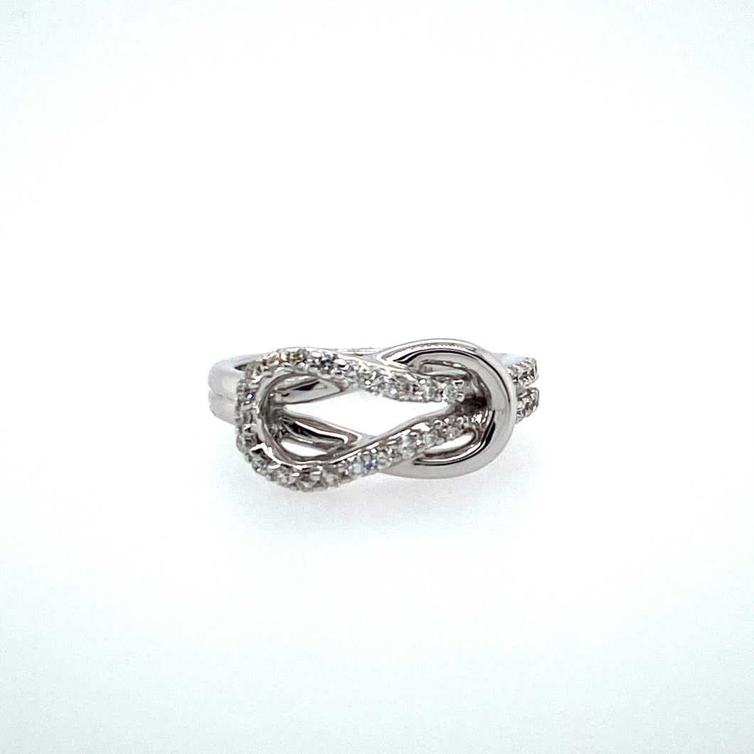 This Beautiful Love Knot Ring, Made with 14 Karat White gold, Measures 8.6mm at its Largest Width. Part of the Knot is set with Sparkling Diamonds.  Finger Size 6  Total Diamond Weight .35 Carat