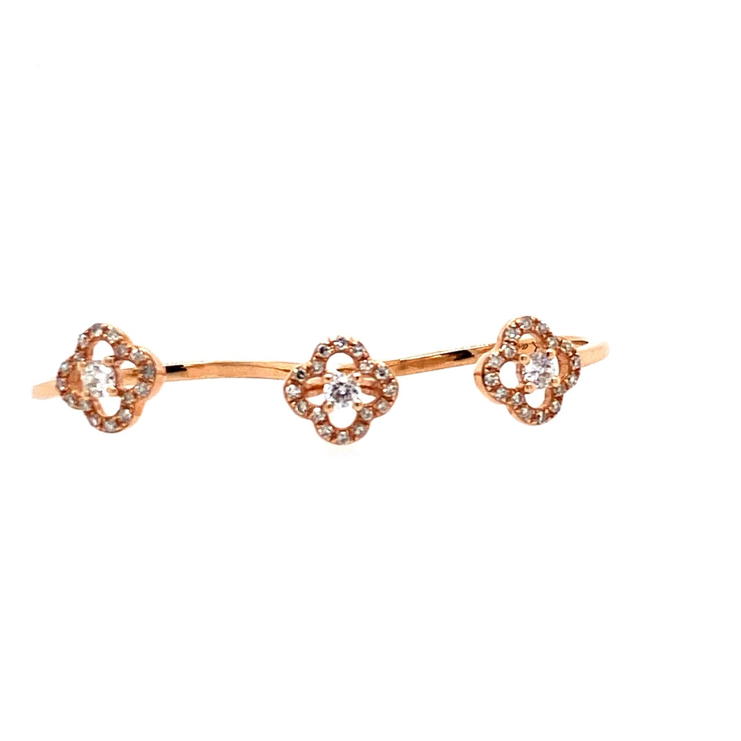 This Sophisticated 14 Karat Rose Gold Piece Features 2 Rings in One.  The Ring Features Three Open Flower Design, set with Sparkling Diamonds.  Finger Size 7 1/2 to 8  Total Diamond Weight .39 Carat