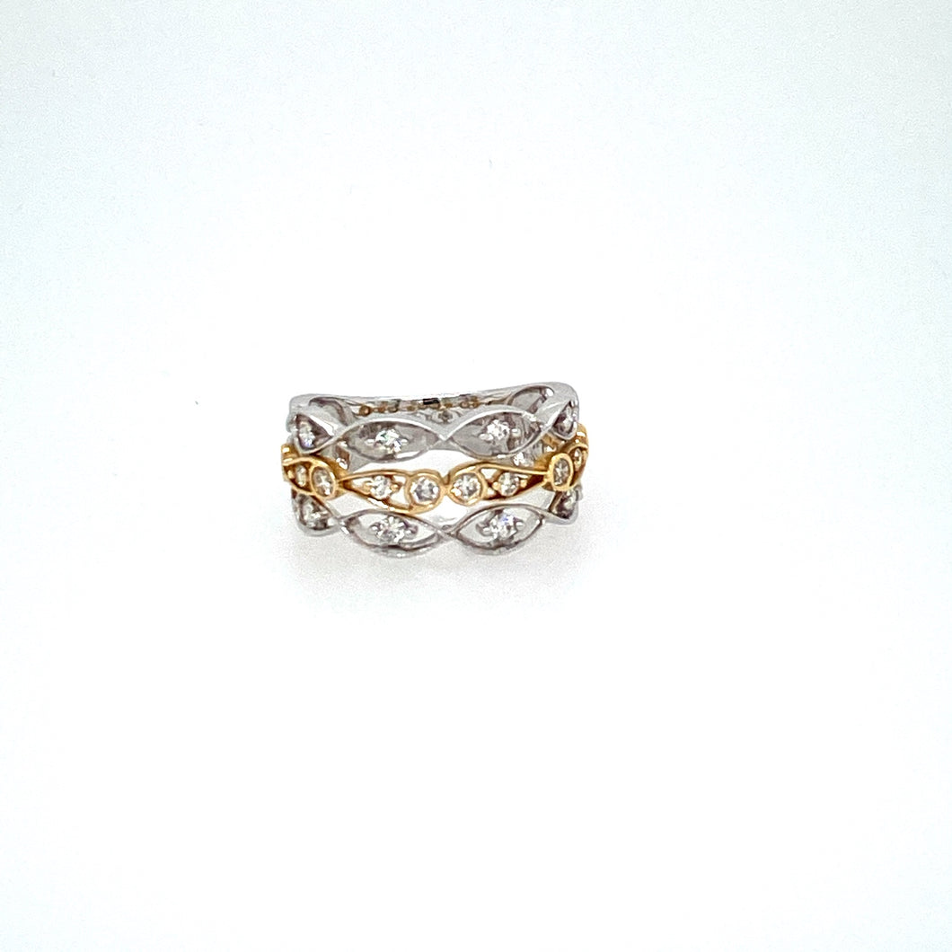 Elegant and Classy describes this 14 Karat White Gold and Yellow Gold Ring. The Three Row Open Band features 1/2 Carat of Sparkling White Diamonds throughout.  Finger Size 6.5