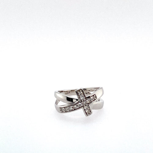 This 14 Karat White Gold Bypass Ring Features a Diamond Cross. Total Diamond Weight .25 Carat
