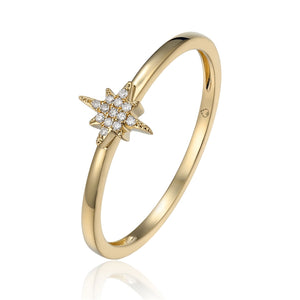 This Dainty Ring made in 14 Karat Yellow Gold and Designed by Luvente Features a High Polished Shank Holding a Star Setting, set with 13 Round Diamonds.   Finger Size 6  Total Weight .81 Grams  Total Diamond Weight .03 Carat