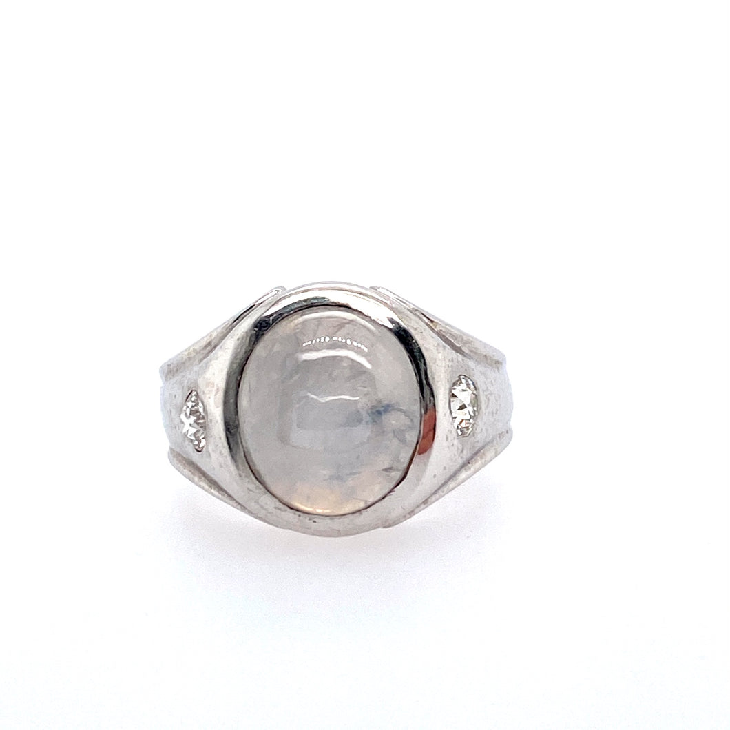 This Men's Estate Ring Features an Oval Gray Star Sapphire with a Burnish Set Diamond set on Both Sides of the Gemstone.   Finger Size 6.75  Total Weight 10.3 Grams Approximate Total Diamond Weight .32 Carat