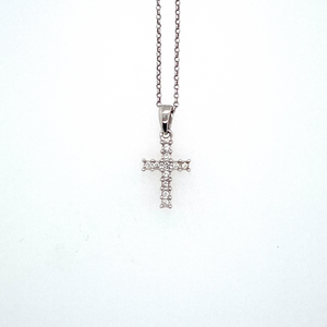 "This Dainty Little 14 Karat White Gold Cross Features 11 Diamonds Prong Set in a Single Row, with a 14 Karat White Gold Bail. The Cross is Hung from a Fine14 Karat White Gold 16"" Link Chain. Measures Approximately 11.0mm x 8.0mm"