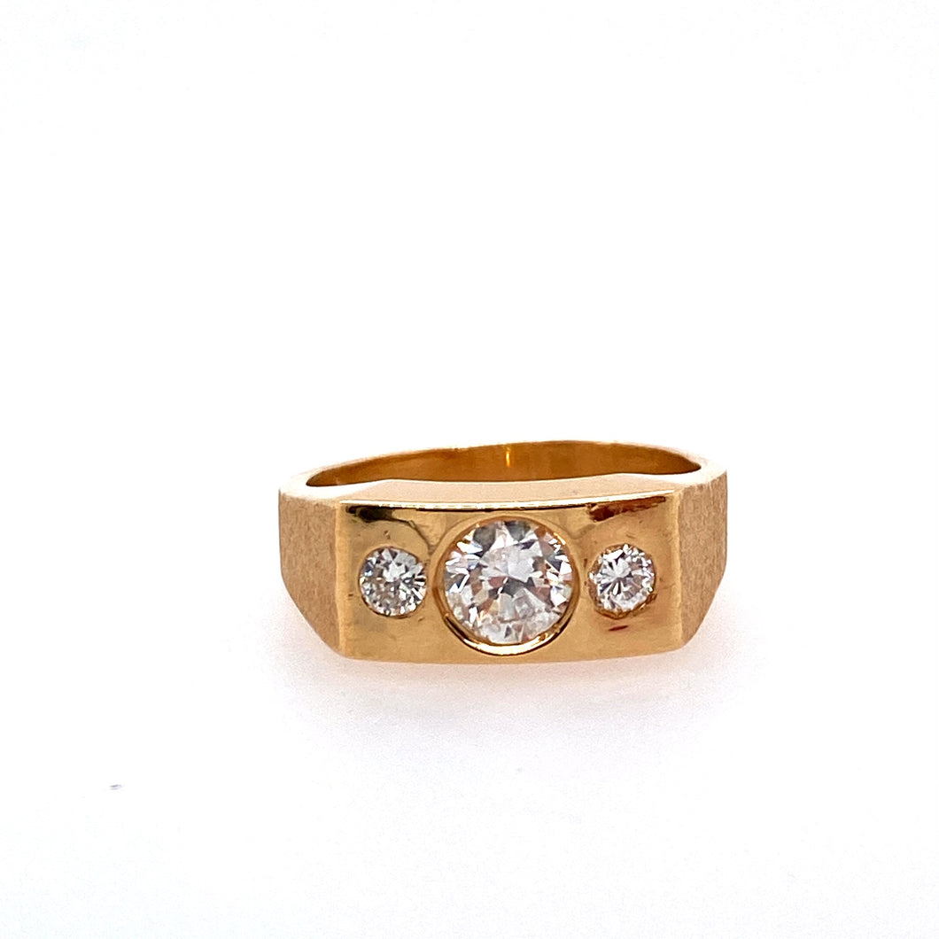 This Men's 14 Karat Yellow Gold Ring Features a Flat Rectangle Top with a Round Bezel Set .50 Carat Diamond in the Center and a Round .25 Carat Burnish Set Diamond on Each Side of the Center.  A Stone Finish Completes the Ring.  Finger Size 9.25  Total Weight 8.8 Grams  Total Estimated Diamond Weight 1.00 Carat . This is an Estate Ring