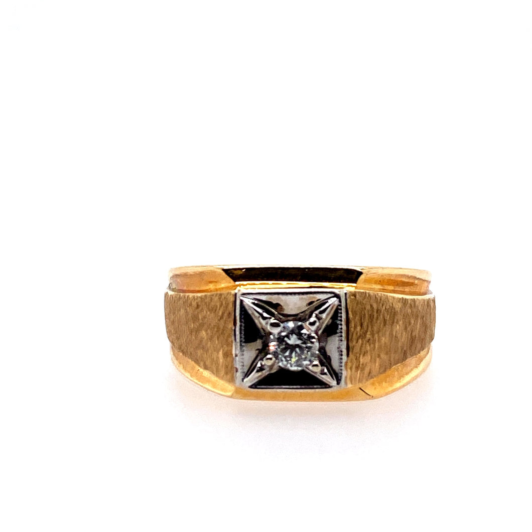 This Men's 14 Karat Yellow Gold Ring Features a Textured finish and a High Polished Finish on the Sides, with a Round Diamond Set into the White Top Square Section.  Finger Size 8.75  Approximate Diamond Weight .17 Carat SI Clarity  Total Weight 7.0 Grams