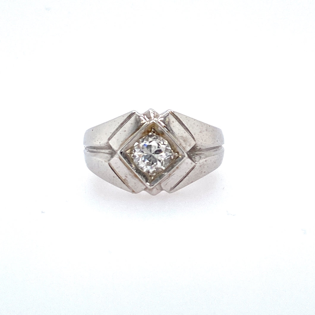 This 14 Karat White Gold Estate Ring Features a .65 Carat SI-1 Clarity and H Color Round Diamond set into a Kite Shaped Center Setting. Finger Size 8.25  Total Weight 6.5 Grams