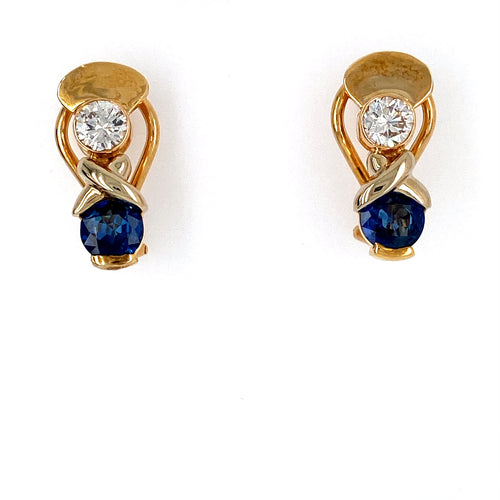This Beautiful Pair of Round Faceted Blue Sapphire Gemstones are set near the Bottom of the Earrings and a Sparkling Round Diamond at the Top with an