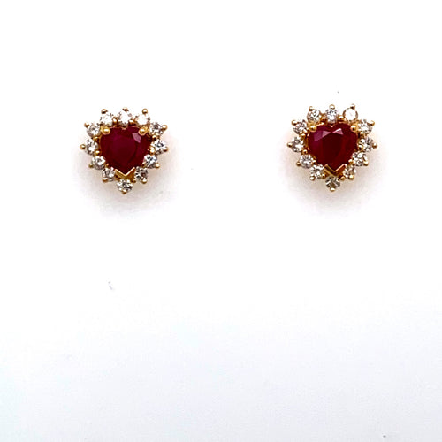 This Beautiful Pair of 18 Karat Yellow Gold Estate Stud Earrings Feature a Heart Shaped Beautiful Red Ruby Gemstone with VS Diamonds surrounding the Stone.  The Earrings are Secured with Posts and Push on Backs.  Total Ruby Weight 1.50 Carats  Total Diamond Weight .50 Carat  All Weights are Approximate in Estate Pieces