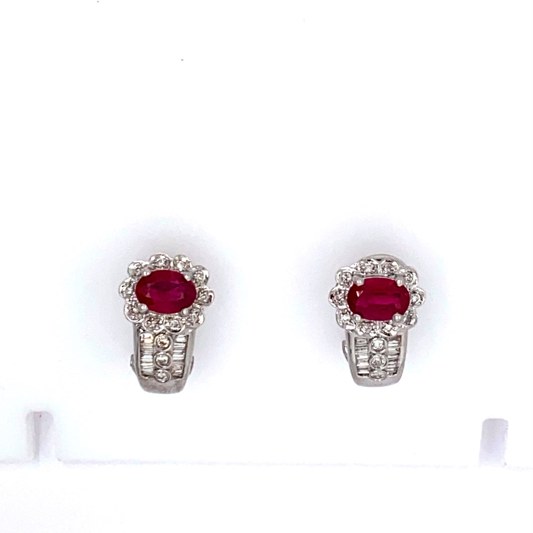 This Stunning Pair of 18 Karat White gold Estate Earrings Feature an Oval Gorgeous Red Ruby Gemstone with Round and Baguette Cut Sparkling Diamonds.  The Earrings Feature Omega Backs.  Total Weight is 7.0 Grams