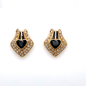 These Beautiful Estate Earrings Feature 14 Karat Yellow Gold with a Heart Shaped Blue Sapphire Gemstone at the Center with Two Rows of Baguette Blue Sapphires above the Heart, along with 1.00 Full Carat of Sparkling White Diamonds set throughout the Pair.  The Earrings are Secured with Posts and Backs.  Estate Weights are Estimated