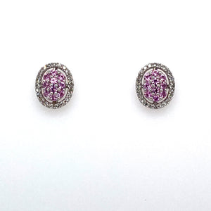 This Pair of 14 Karat White Gold Oval Earrings Feature Pink Sapphire Gemstones and White Sparkling Diamonds.  The Earrings are Secured with Posts and Push on Backs.  Total Diamond Weight .25 Carat  Total Weight 3.1 Grams