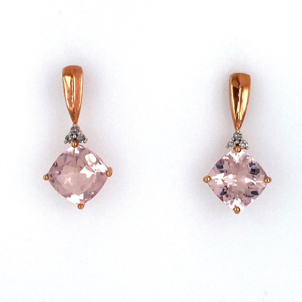 This Pair of 14 Karat Rose Gold Earrings Feature a Kite Shaped Morganite with a Diamonds above the Stone and Fluted Rose Gold Going Towards the Ear. The Earrings are Secured with Posts and Push on Backs.