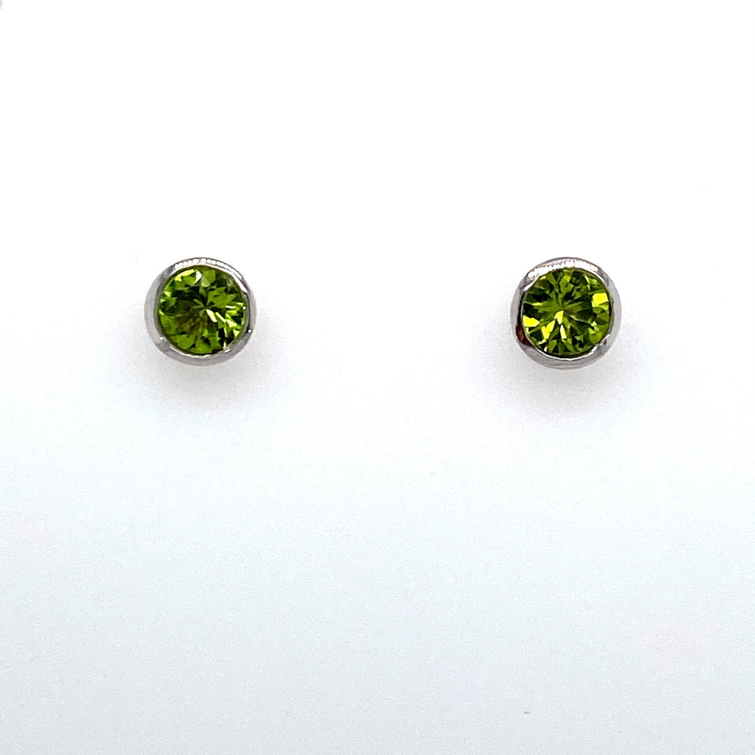 This Pair of Stud Earrings made out of 14 Karat White Gold with Posts and Push on Backs Features a Bezel Set Peridot Gemstone. If you Love Green or you are an August Baby, this Pair of Studs is for you.