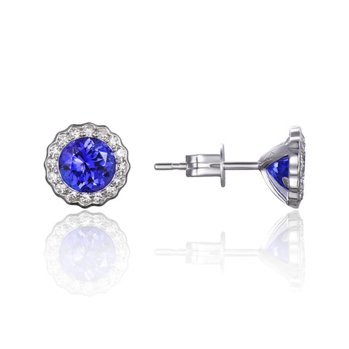 14 karat white gold 1.11ctw tanzanite stud earrings with .22ctw diamond halo