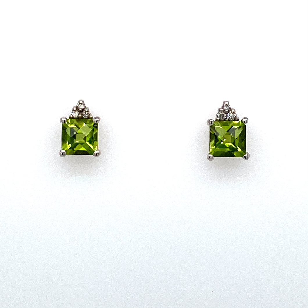 This Pair of 10 Karat White Gold Square Shaped Peridot Earrings have 3 Diamonds at the Top of Each Earring for some Added Sparkle.  They are Secured with Posts and Backs.