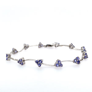 "This Delicate Bracelet Features 3 Round Tanzanite Gemstone into Each Setting to Give it a Triangular Shape, with Twisted White Gold Bar Links In-Between. This Dainty Pretty Bracelet is Secured with a Lobster Clasp   Total Weight is 5.0 Grams  Total Length is 7"" . Metal is 14 Karat White Gold"