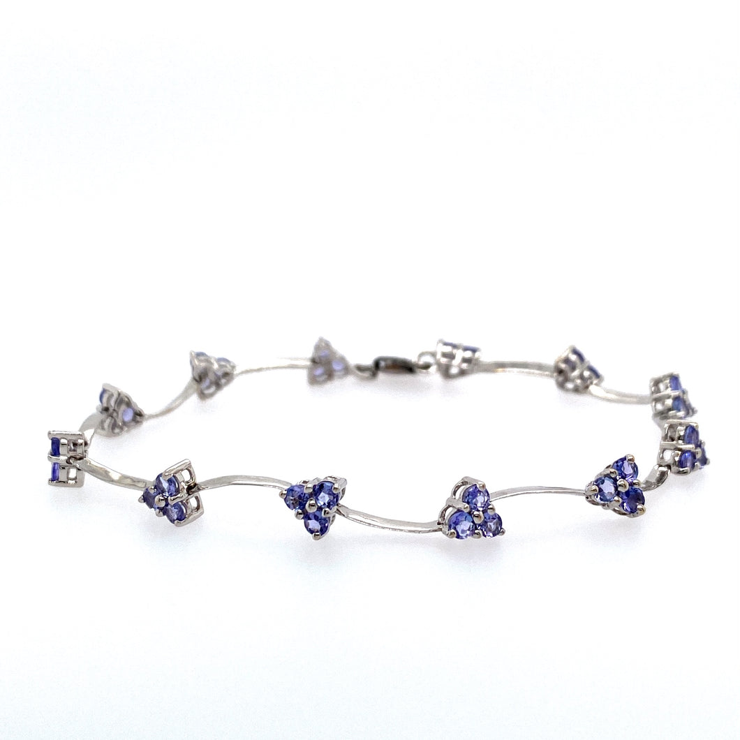 This Delicate Bracelet Features 3 Round Tanzanite Gemstone into Each Setting to Give it a Triangular Shape, with Twisted White Gold Bar Links In-Between. This Dainty Pretty Bracelet is Secured with a Lobster Clasp   Total Weight is 5.0 Grams  Total Length is 7