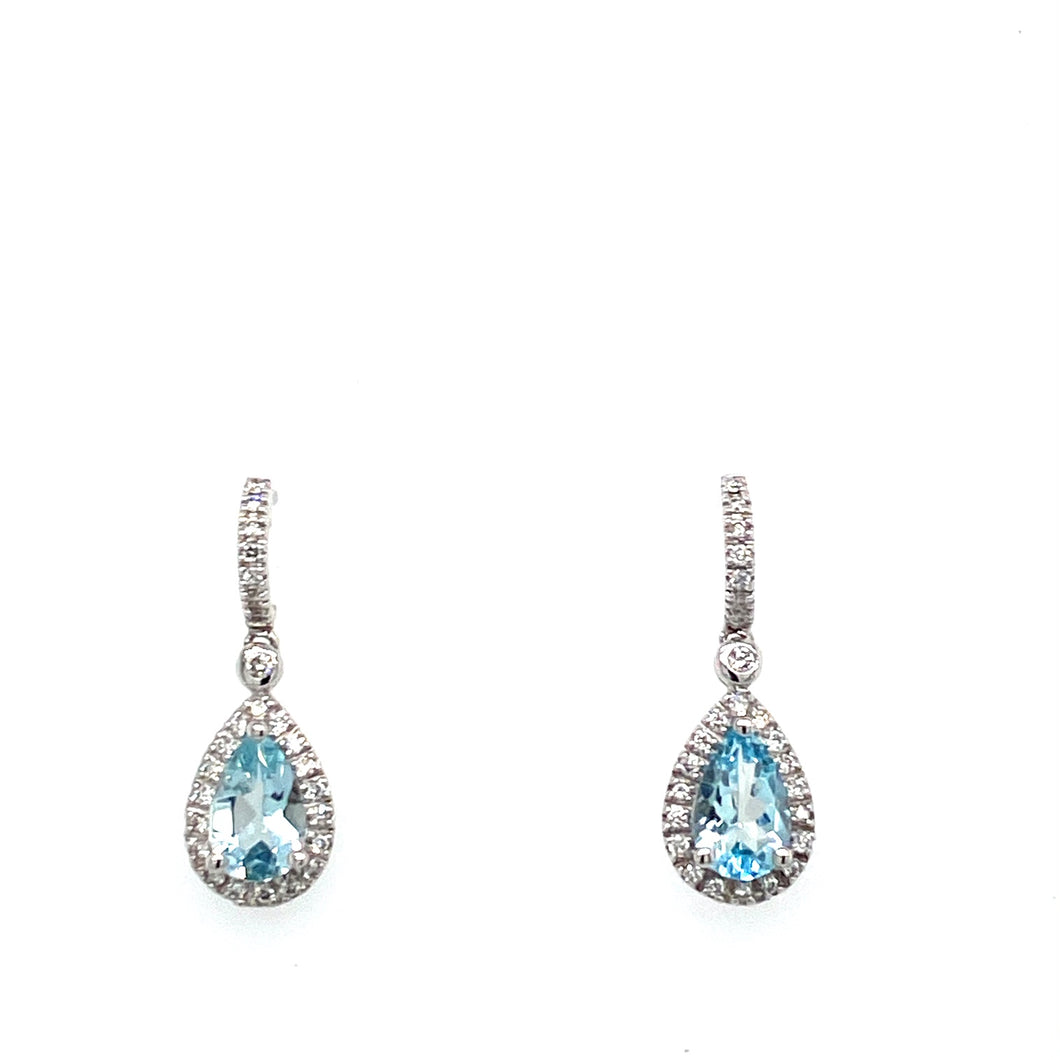 This Pair of 14 Karat White Gold Drop Earrings Feature a Pear Shaped Aquamarine Gemstone Embellished by a Diamond Halo. The Earrings are Secured with Posts and Push on Backs  Total Gemstone Weight 1.28 Carats