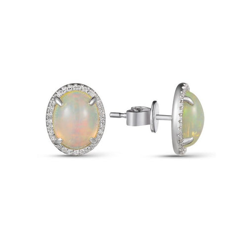 14 karat white gold opal earrings.  Each earring contains one 1.26 carat oval opal with 28 diamond halo around it