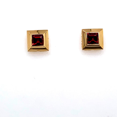 This Simple Pair of 14 Karat Yellow Gold Earrings Feature a Square Garnet Gemstone.  the Earrings are Secured with Posts and Push on Backs. Total Weight 4.5 Grams