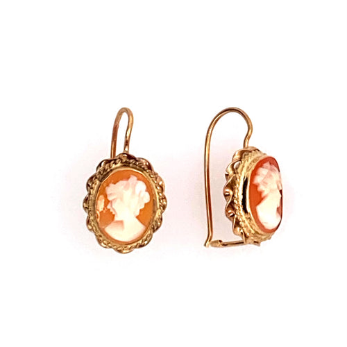 This Pair of 14 Karat Yellow Gold Estate Earrings Feature a Cameo of a Lady. The Cameo's Measure Approximately 11.0mm x 13.0mm and are Secured with Shepherd's Hook Backings. Total Weight 3.1 Grams