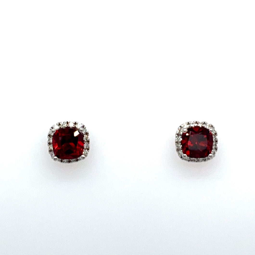 Each 14 Karat White Gold Earring Features a 1.15 Carat Cushion Cut Red Garnet Gemstone, Embellished with a Diamond Halo. The Earrings are Secured with Posts and Push on Backs.