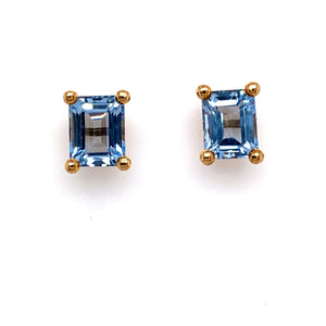 These Estate Earrings Feature an Emerald Cut Step-Cut Synthetic Blue Spinel Stone, set with Four 18K Yellow Gold Prongs. the Earrings are Secured with Posts and Push on Backs.   Total Weight 7.5 Grams  Synthetic Blue Spinel Measures 13.0mm x 10.0mm  all Weights are Approximate with Estate Jewelry
