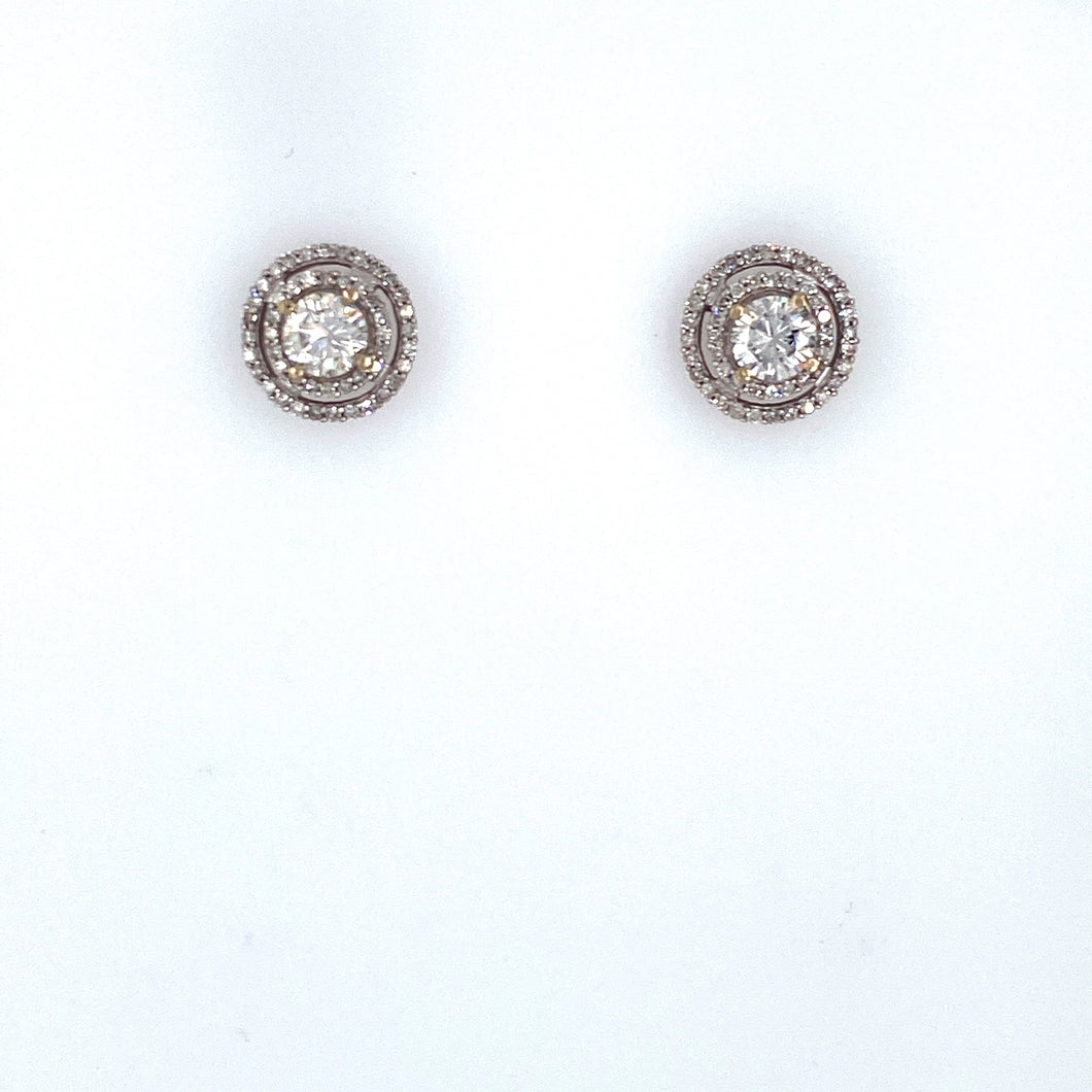 This Pair of 14 Karat White Gold Earrings Feature 2 Round Diamond Studs with a Double Diamond Halo around it.  Total Diamond Weight 1.07 Carats  SI-1 Clarity, H-I Color