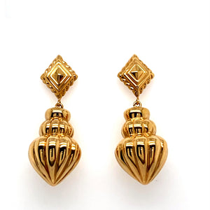 This Pair of 14 Karat Yellow Gold Estate Dangle Earrings Feature a Kite Shape Top with a Larger Fluted Hollow Dangle.  The Earrings are Secured with Posts and Push on Backs.