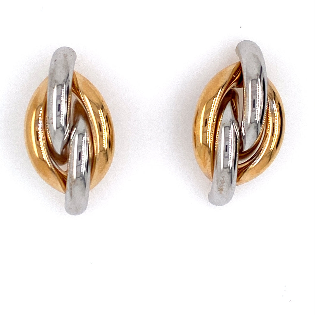 These Fun 14 Karat Yellow Gold Two Tone Earrings Feature a Twist of Yellow Gold and White Gold. The Earrings are Secured with Posts and Push on Backs.  Total Weight 4.2 Grams