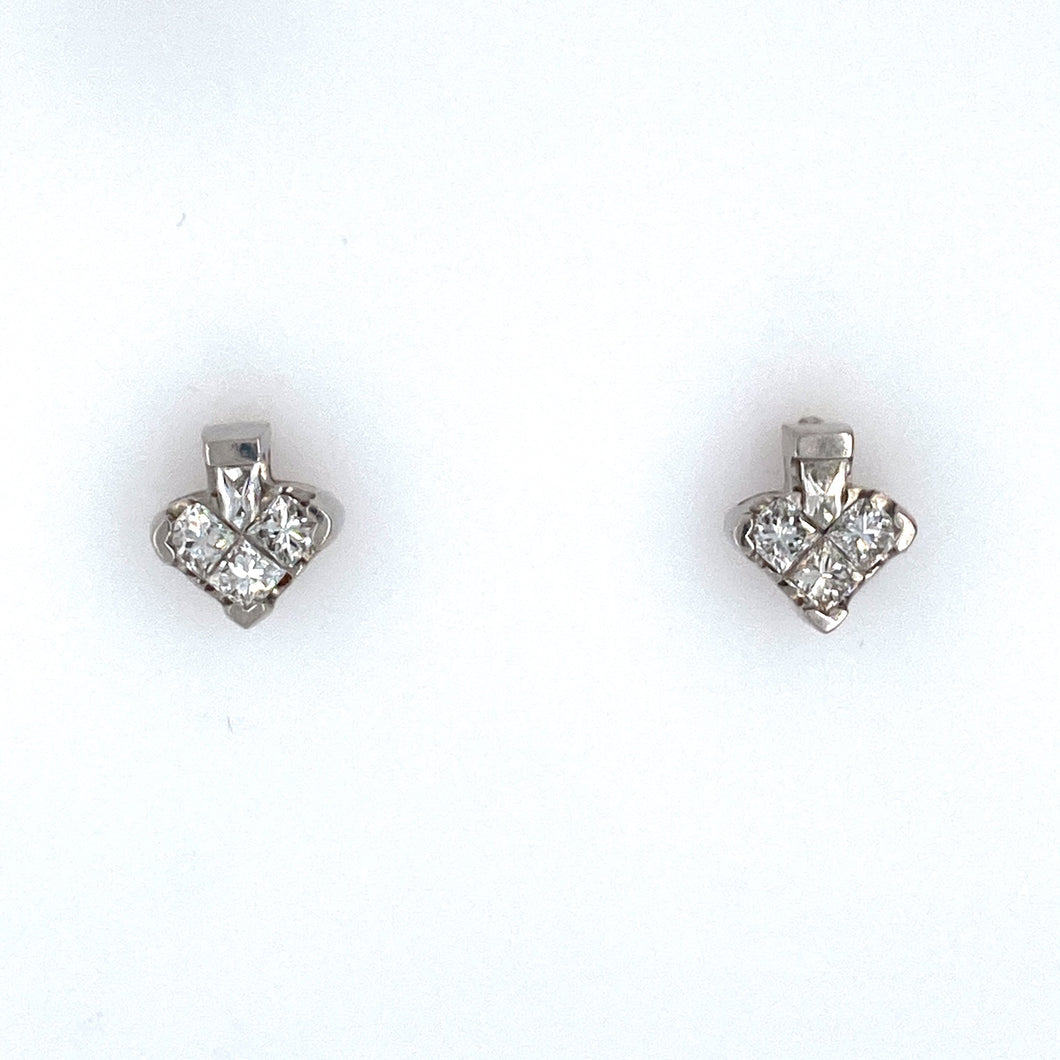 This Pair of Heart Shaped Estate Platinum Earrings Feature a Total of Six Princess-Cut VS Diamonds. The Stud Earrings are Secured with Posts and Screwbacks.  Total Diamond Weight .71 Carat  All Weights are Approximate
