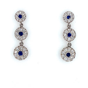 This Pair of 14 Karat White Gold Earrings Feature Three Round Sapphire Gemstones set into Three White Gold Round Links with a Diamond Halo Accent around the Gemstones. The Earrings are Secured with Posts and Push on Backs.  Total Gemstone Weight 1.00 Carat