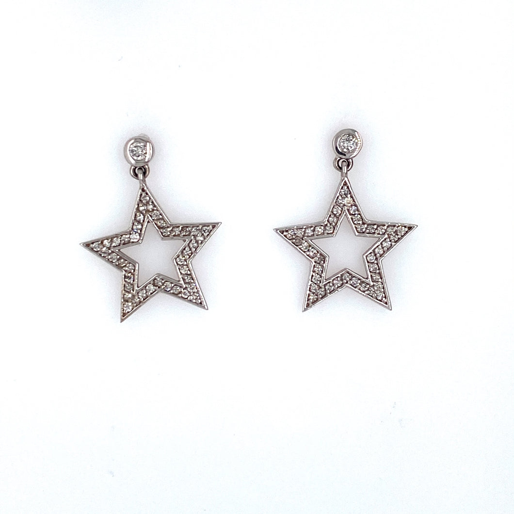 This Pair of 14 Karat White Gold Earrings Feature a Bezel Set Round Diamond at the Top with a Open Diamond Star Dangling from the Bottom. The Earrings are Secured with Posts and Screw Backs.  Total Diamond Weight .47 Carat