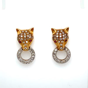 "These Stunning ""Panther"" Earrings Feature 14 Karat White Gold and Yellow Gold with .76 Total Carat Weight of Diamonds and Round Rubies are set for the Eyes.  The Earrings are Secured with Posts and Push on Backs.  Total Weight 8.6 Grams  Diamond Weight is Estimated in estate pieces"