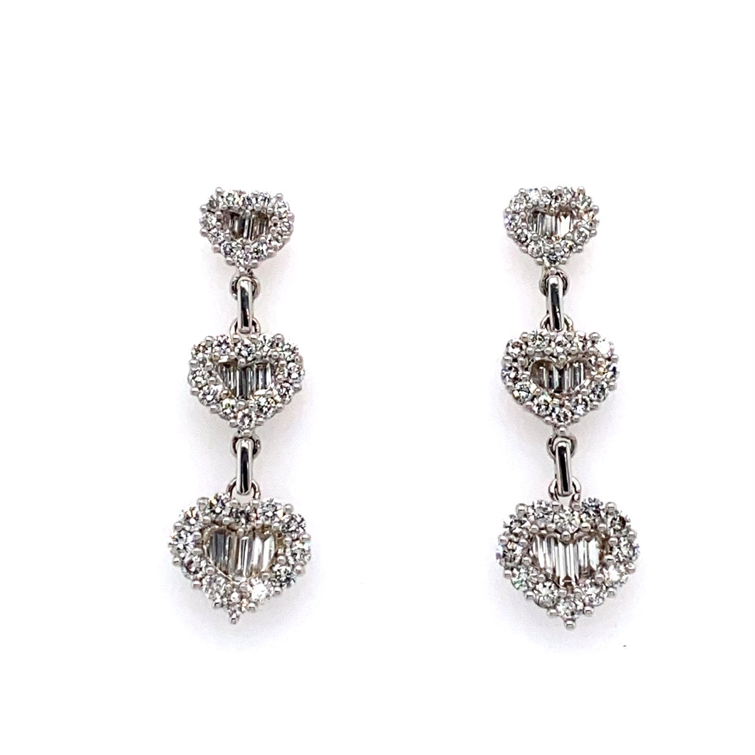 This Gorgeous Pair of Estate Earrings Feature Three Heart Drop Settings Encasing Baguette Cut Diamonds in the Center, and Round Diamonds on the Outside. These Long Drop Earrings are Secured with Posts and Push on Backs.  Estimated Total Diamond Weight = 2.95 VS Diamonds  Total Weight 8.3 Grams