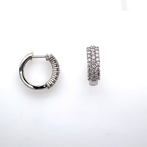 This Sparkling Pair of Estate 14 Karat White Gold Huggie Style Earrings Features Three Rows of Round Diamonds. The Earrings are Secured with Click in Posts.  Total Estimated Diamond Weight 1.00 Carat  Total Weight 5.1 Grams