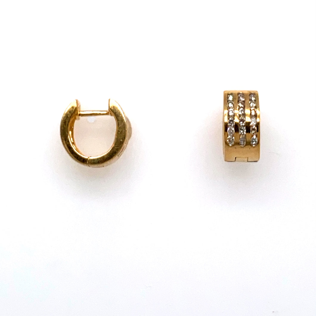 This Pretty Pair of Estate High Polished 14 Karat Yellow Gold Earrings Feature Three Rows  of Channel Set Round Diamonds (36 Total).  the Earrings are Secured with Click in Posts.  Total Weight 4.2 Grams
