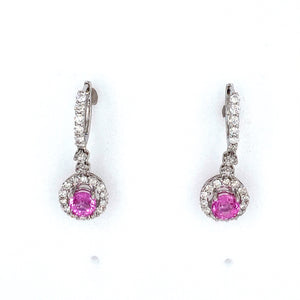This Pair of Beautiful 18 Karat White Gold Drop Earrings Feature a Round Bright Pink Sapphire Gemstone with a Diamond Halo Dangling from the Bottom of the Earring with Diamonds Going up the Top of the Click in Back Earrings.  Total Gemstone Weight 1.27 Carats  Total Diamond Weight .92 Carat