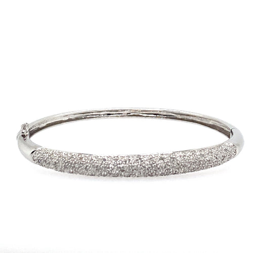 This 14 Karat White Gold Bangle features 104 Diamonds. The Hinged Bracelet features a safety 8 for added security.  Total Weight 13.0 Grams