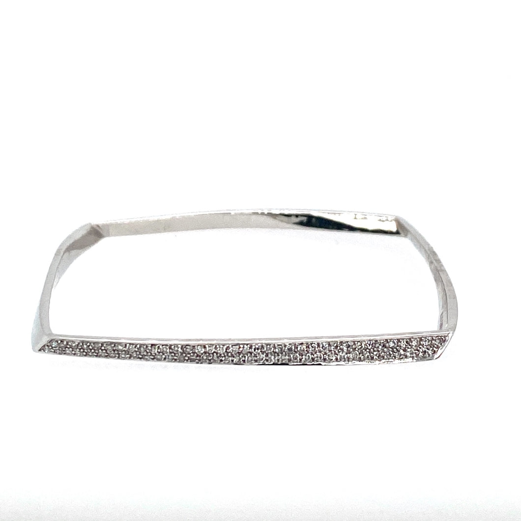 A Modern Twist to a Slip on Bangle, this 14 Karat White Gold Square Shaped Slip-on Bracelet is Pave set with .50dtw of Diamonds.  Total Weight is 17.4 Grams