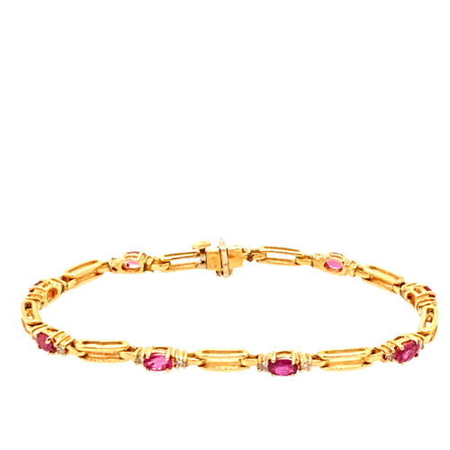 14 Karat Yellow Gold and Rubies Pair together in this Rectangle Open Link Bracelet, and in-between each open link their is a total of  8 Links of Oval Ruby Gemstones with a Diamond set on each Side. Length is 7