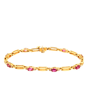 "14 Karat Yellow Gold and Rubies Pair together in this Rectangle Open Link Bracelet, and in-between each open link their is a total of  8 Links of Oval Ruby Gemstones with a Diamond set on each Side. Length is 7""  Total weight is 10.1 Grams"
