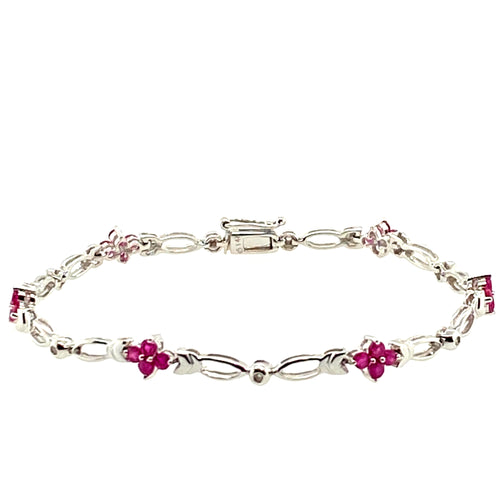 Light up your look with this 14 Karat White Gold Open Link Style Ruby and Diamond Bracelet. In-between each Open link is a