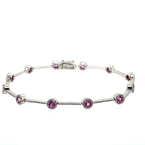 It's like Cotton Candy! this 14 Karat White Gold Bracelet Features 12 Round Pink Sapphire Gemstones surrounded by a Diamond Halo, along with a Straight line of Diamonds in-between the gemstones   Length is 7.25