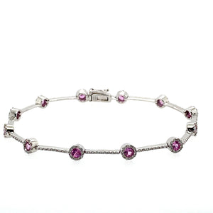 "It's like Cotton Candy! this 14 Karat White Gold Bracelet Features 12 Round Pink Sapphire Gemstones surrounded by a Diamond Halo, along with a Straight line of Diamonds in-between the gemstones   Length is 7.25""  Total Weight is 7.6 Grams"